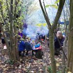Forest school gathered by the fire